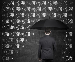 businessman with umbrella and thumb down rain